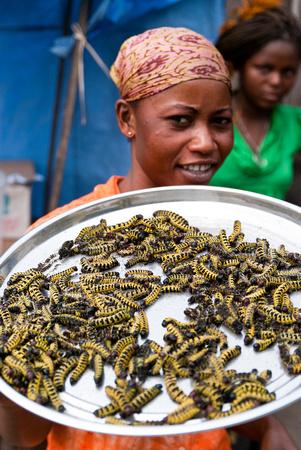 A woman sells caterpillars in Kinshasa, Democratic Republic of the Congo.