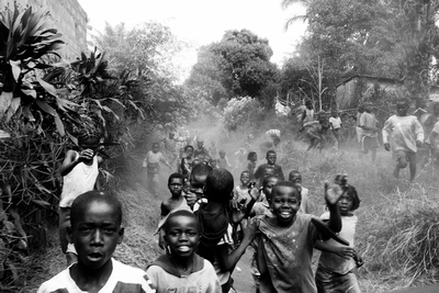 Children start to chase after our vehicle in Ndjili, near Kinshasa in the Democratic Republic of the Congo.